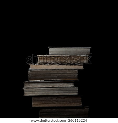 Vintage books stack isolated on black background