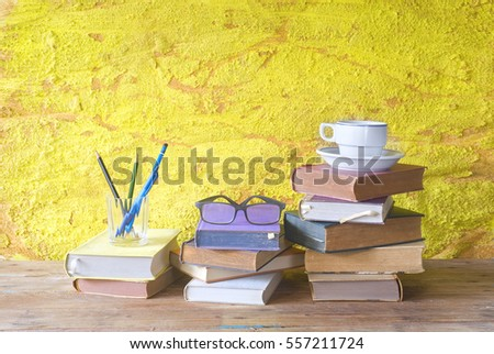 vintage books with cup of coffee, specs and pens, free copy space