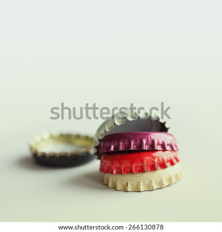 Vintage bottle caps on pastel background. Macro view (soft focus) - stock photo