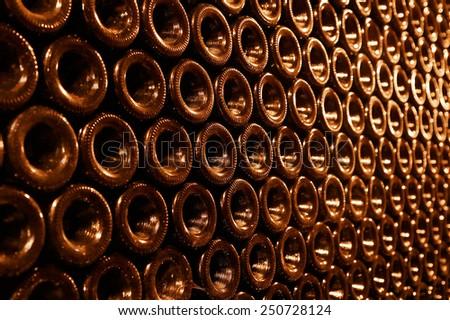vintage bottles in the wine cellar - stock photo