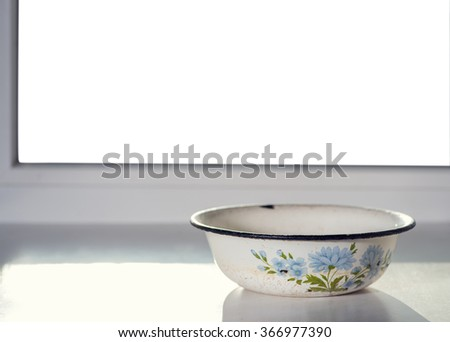 Vintage bowl on the window with isolated background - stock photo