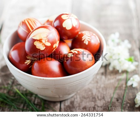 Vintage Bowl with Easter Eggs Decorated with Natural Fresh Leaves and Boiled in Onions Peels - stock photo