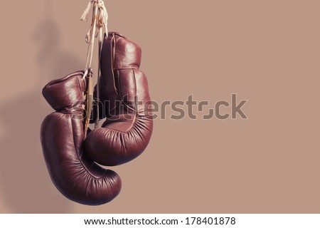 vintage boxing Gloves, hanging - stock photo