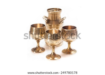 Vintage brass cups on white background