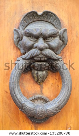 Vintage brass door knob on the wooden background - stock photo