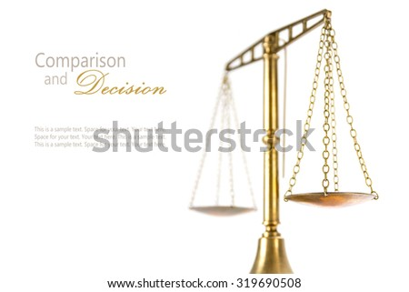 vintage brass scales of justice isolated on a white background, concept comparsion and decision, closeup shot with selected focus and narrow depth of field - stock photo