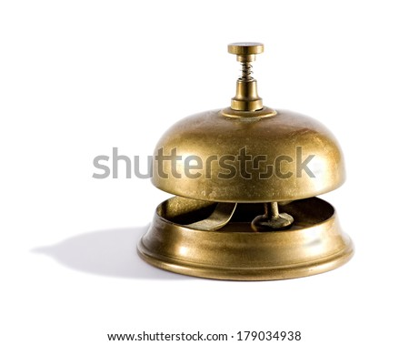Vintage brass service bell usually found in a hotel or club reception for a customer to summon assistance on a white background - stock photo
