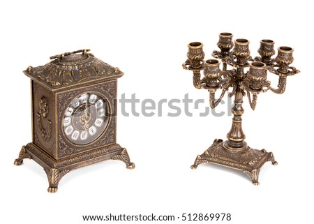 Vintage bronze candle holder and clock on a white background