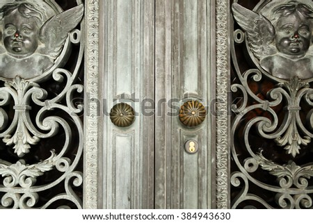 Vintage bronze door detail. - stock photo