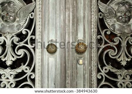 Vintage bronze door detail. - stock photo