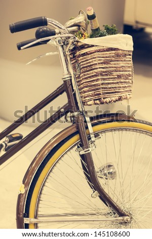 Vintage Brown Bicycle with Basket - stock photo