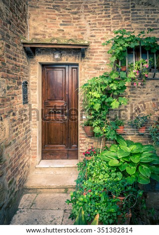 Vintage brown doors somewhere in Tuscany, Italy - stock photo