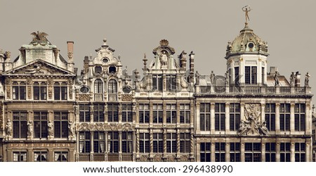 Vintage brown filter on historical buildings located in Grand Place of Brussels, Belgium. - stock photo