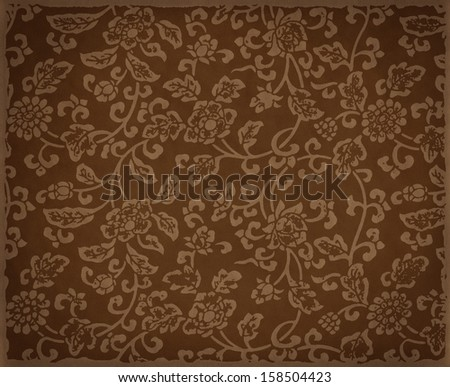 Vintage brown floral background, flowers ornament on leather texture