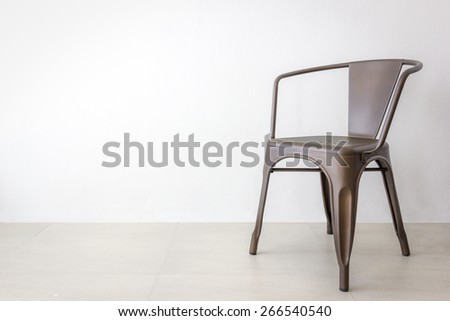 vintage brown iron or metal chair on soft gray color background - stock photo