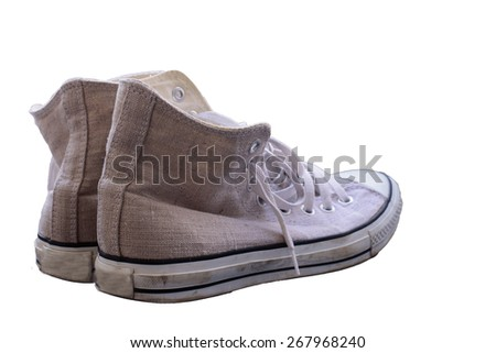 vintage brown shoes on white background,old sneakers on white background. - stock photo