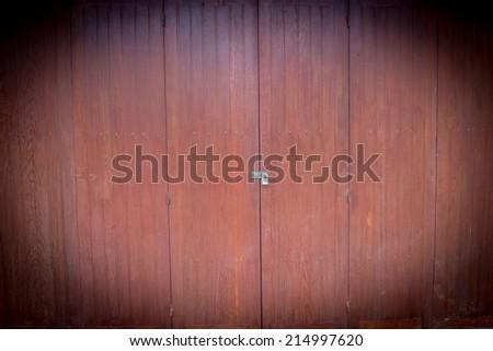 vintage brown wooden door on background - stock photo