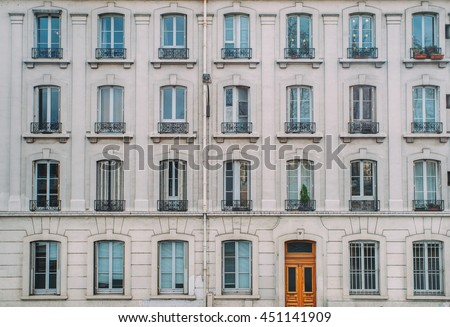 Vintage building facade wall rounded windows stock photo for Classic house facades