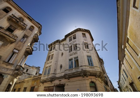Vintage building facades in Old havana street against blue sky - stock photo