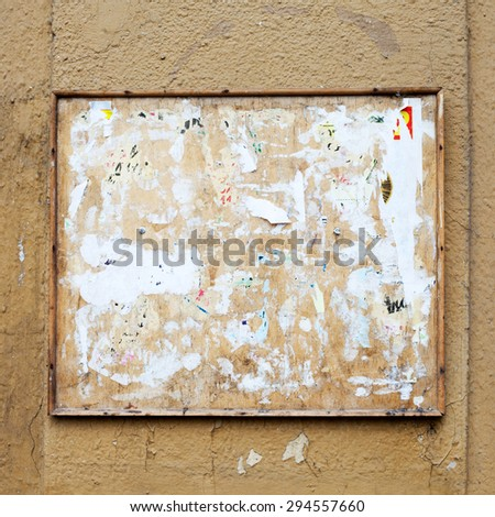 Vintage bulletin Square board. aged dirty street wall background.  - stock photo