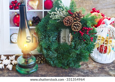 vintage burning lantern with  christmas wreath and decorations  - stock photo