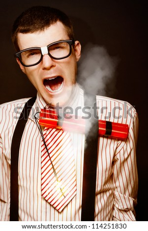 Vintage Businessman Dork With A Bomb Tucked Under Suspenders In A Explosive Stress Conceptual On Black Background - stock photo