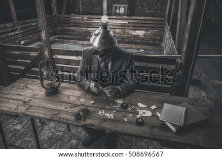 Vintage businessman sitting by office desk