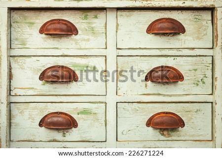 Vintage cabinet with six drawers and rusted handles - stock photo