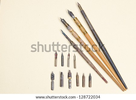 Vintage calligraphy pens and nibs from early 1900s - stock photo