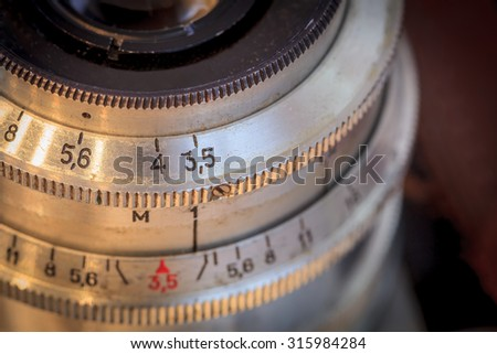 Vintage camera lens close up. Selective focus. Shallow depth of field.  - stock photo