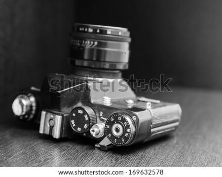 Vintage camera lying on a dusty closet shelf - stock photo