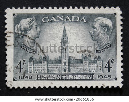 Vintage Canadian postage stamp with images of Queen Victoria and King George VI