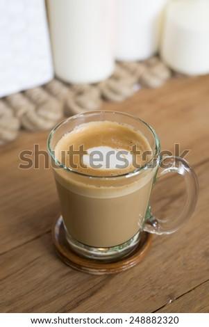 Vintage, Cappuccino Coffee on wooden table background. - stock photo