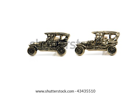 Vintage car cuff links isolated on white