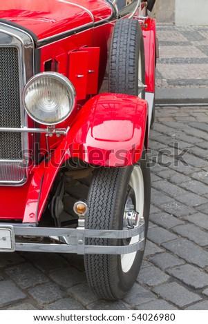 Vintage car. Red retro automobile - stock photo