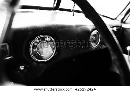 Vintage car speedometer. Close up shot of the dashboard at classic car. - stock photo