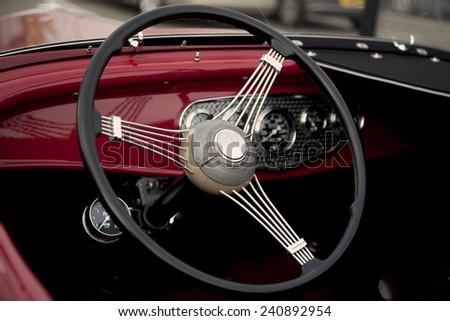 Vintage Car Steering Wheel - stock photo