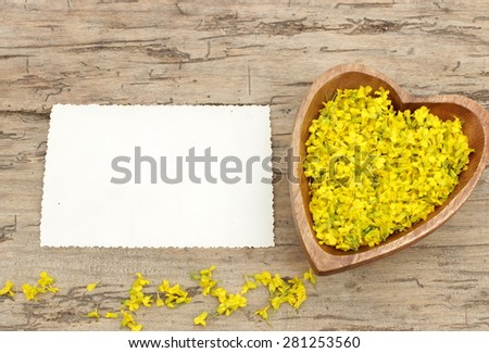 Vintage card for greetings with wooden background and yellow wildflowers - stock photo