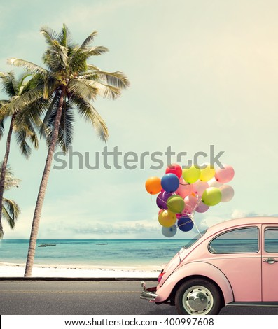 Vintage card of car with colorful balloon on beach blue sky concept of love in summer and wedding honeymoon - stock photo
