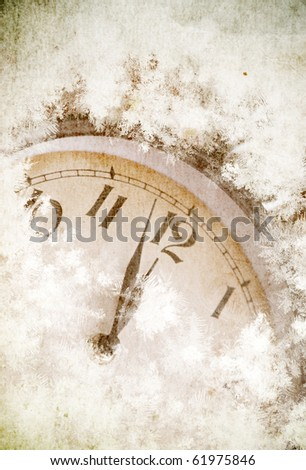 Vintage card of clock covered with snow - stock photo