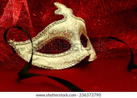 Vintage carnival mask in red background - stock photo