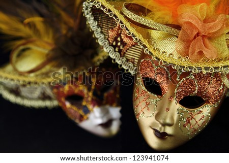 Vintage carnival masks on black background - stock photo