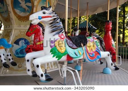 Vintage carousel horse ride. Selective focus - stock photo