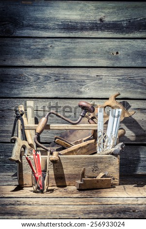 Vintage carpenter tools in wooden toolbox - stock photo