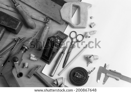 Vintage carpentry workplace. 'Still life' with old carpentry's tools. Black'n'white horizontal composition - stock photo