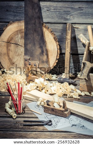 Vintage carpentry workshop with tools - stock photo
