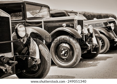 Vintage cars, black and white - stock photo
