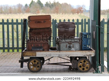 Vintage Cases on a Traditional Railway Luggage Trolley. - stock photo