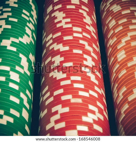 Vintage casino chips pile - stock photo