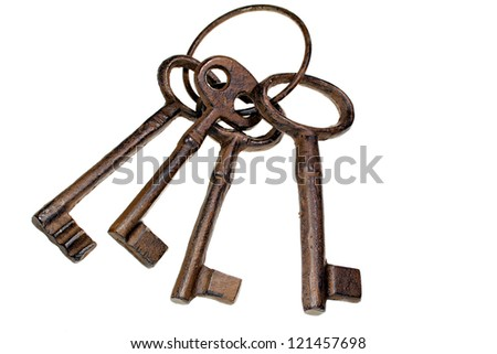 Vintage cast iron keys on a ring - stock photo
